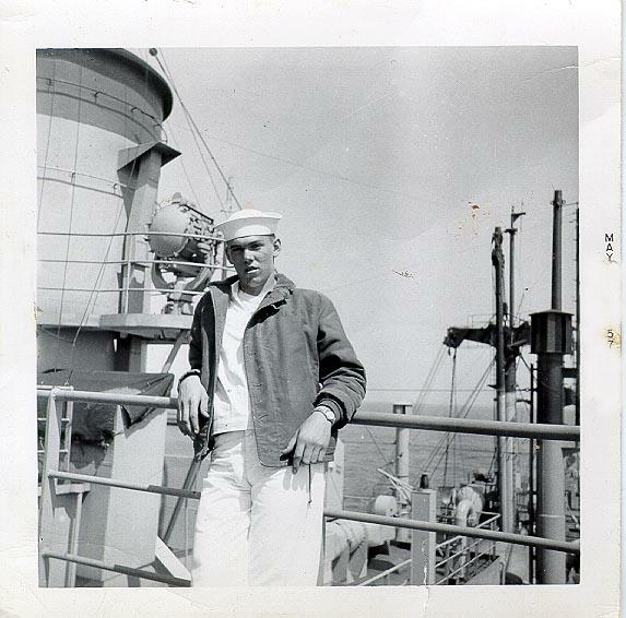 QM3 John Ackerman on signal bridge 1957